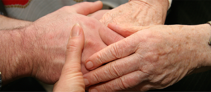 Hands holding together across generations